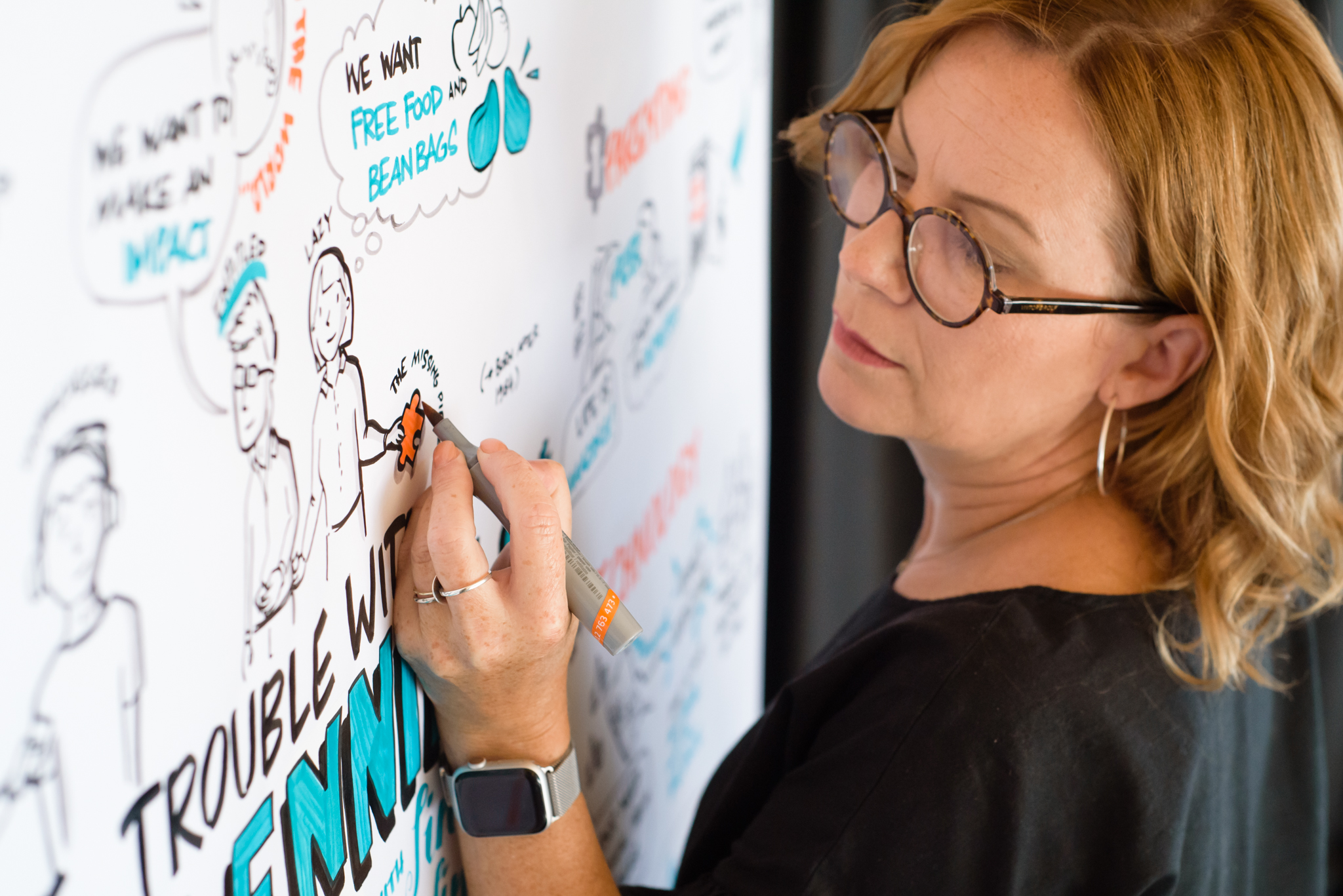 Debbie Wood – graphic recording analog style at the wall